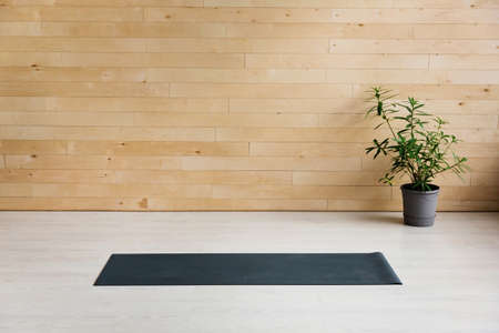 Empty yoga mat on the floor. Equipment for yoga. Concept healthy lifestyle Imagens
