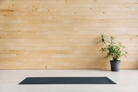 Empty yoga mat on the floor. Equipment for yoga. Concept healthy lifestyle Reklamní fotografie