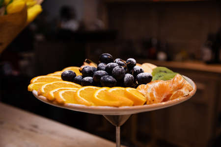 Plate with fruits on the festive table in a restaurant