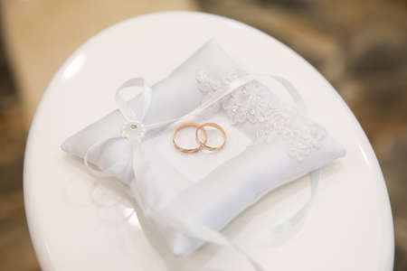 Gold wedding rings on stand for rings
