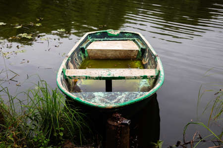 Wooden boat on the lake. Fishing boat