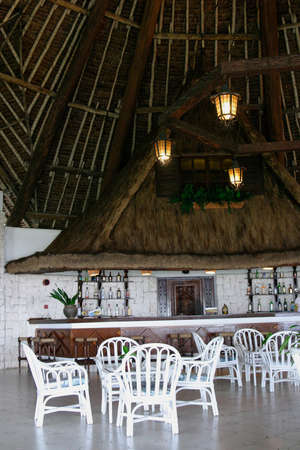 wicker bar: tropical bar in hotel with white wicker chairs