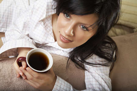 young woman is having her morning tea Stock Photo - 2262639