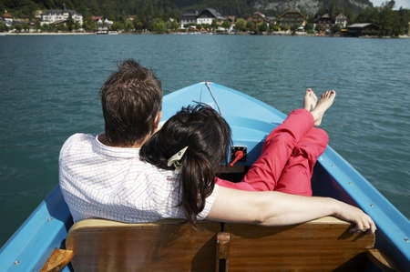 young couple boating on the lake in Austria photo