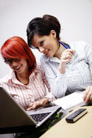 Two businesswomen are working in the office photo