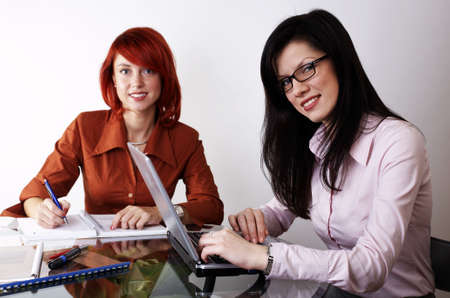 Two businesswomen are working at the office photo