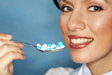 beautiful caucasian doctor with whiteblue pills photo