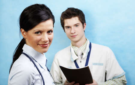 young causasian doctor with assistant photo