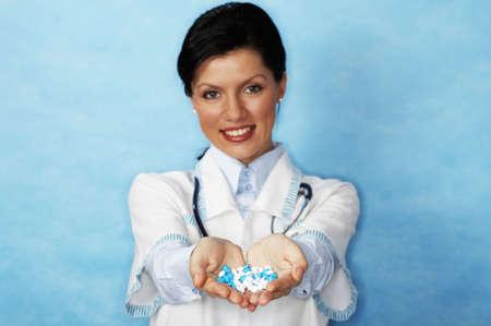 beautiful caucasian doctor with whiteblue pills (shallow DOF) photo