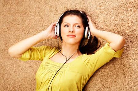 Beautiful women listening music in headphones photo