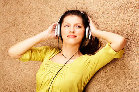 Beautiful women listening music in headphones Stock Photo - 2797396