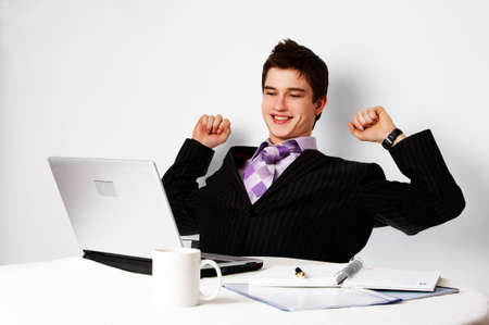 young successful confident man with laptop, triumph photo