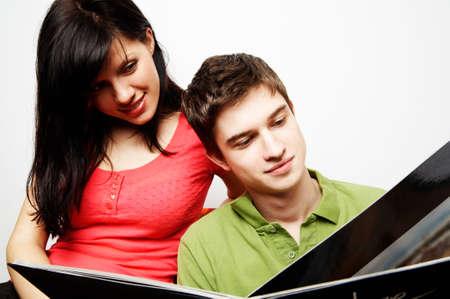 young happy couple with photo album Stock Photo - 2903551