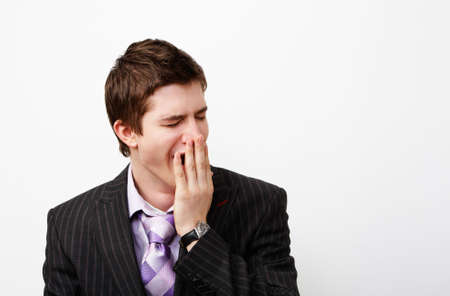 ennui: tired young handsome manager Stock Photo