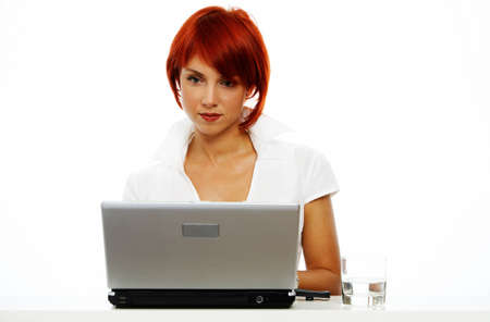 young smiling business women with laptop photo