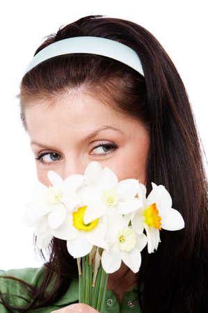 admire: young smiling woman is holding flowers
