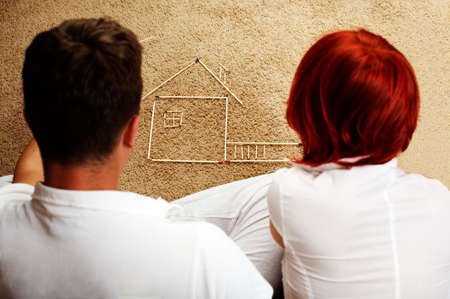 dreaminess: young couple building a house Stock Photo
