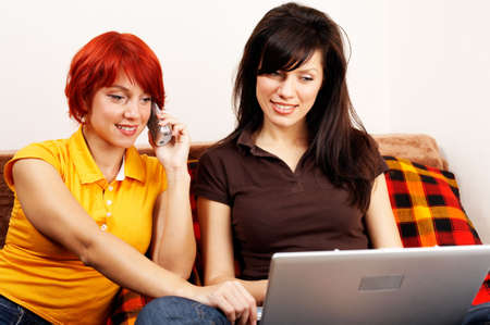 careless: two young women with laptop and phone