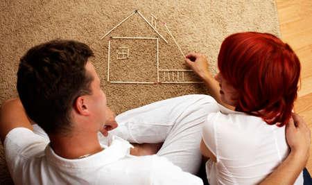 bilding: young caucasian couple bilding a house