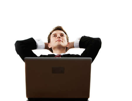 successfulness: young successful confident man with laptop dreaming Stock Photo