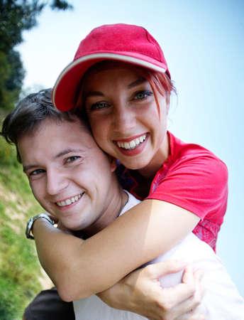 young happy coupleon vacation, piggyback Stock Photo - 3625655