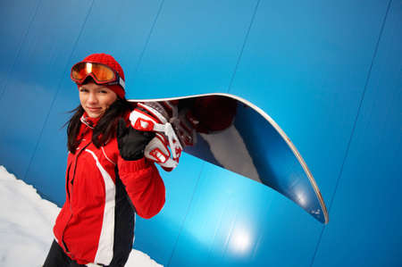 young adult female (age 20-25) snowboarder. photo