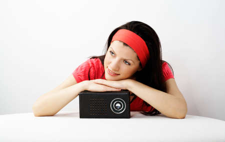 young smiling caucasian woman is listening radio photo