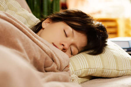 young pretty woman is sleeping at home Stock Photo