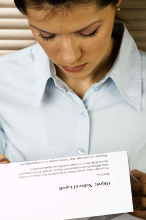 layoff: Young caucasian businesswoman received the notice of layoff