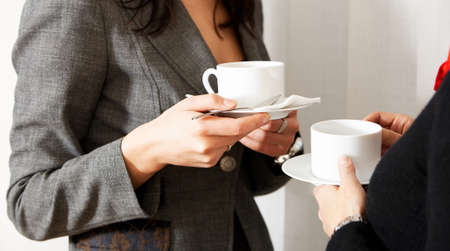 caffee: two women are drinking caffee in the office Stock Photo