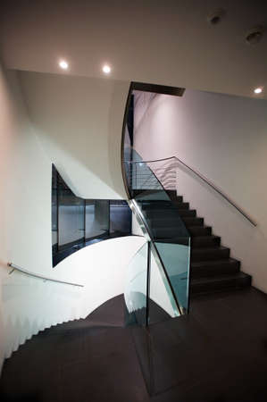 triplex: modern staircase with stainless steel hand rail Stock Photo