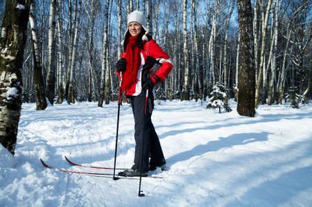 salubrious: young strong woman is skiing in the forest Stock Photo