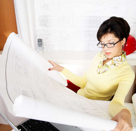 young caucasian engineer with blueprints in the office Stock Photo - 4408366