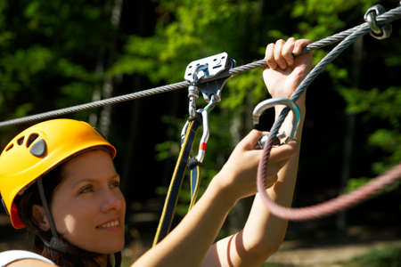 professional climbing gear with helmet pulley and carabiner photo