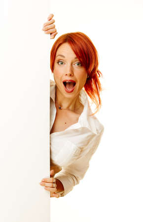 woman pointing: adult girl showing on the message on blank billboard Stock Photo