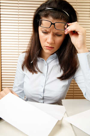 layoff: woman as office worker is reading notice of layoff