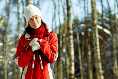 young strong woman is skiing in the forest photo