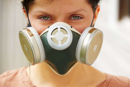 caucasian woman is wearing a gas mask Stock Photo