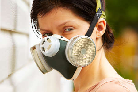 respirator: caucasian woman is wearing a gas mask Stock Photo