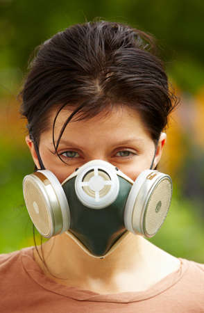 dust mask: caucasian woman is wearing a gas mask Stock Photo