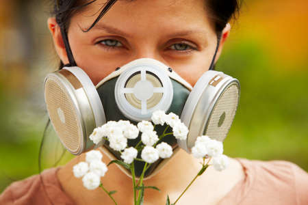 caucasian woman is wearing a gas mask photo