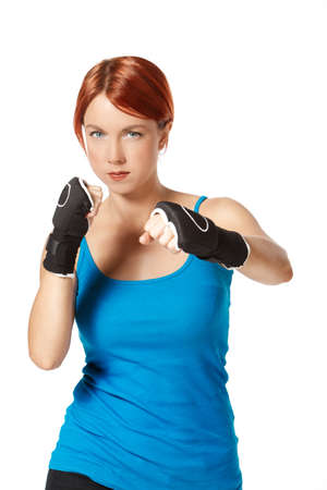 beautiful caucasian female boxer wearing boxing gloves photo