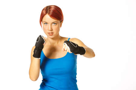 kickboxing: beautiful caucasian female boxer wearing boxing gloves