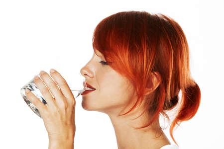 young red haired woman is drinking mineral water Stock Photo - 10944921