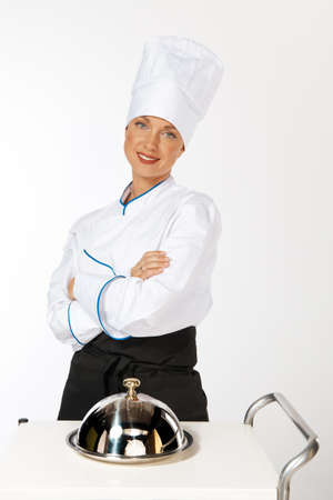 chefs whites: happy smiling caucasian female chef introducing new dish