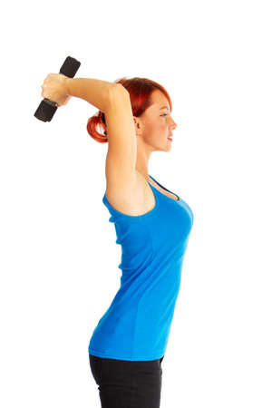 Beautiful caucasian woman curls dumbbells over white background photo