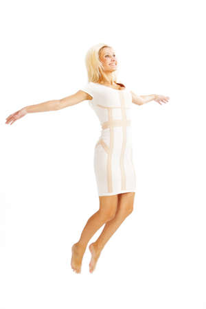 levitation: gorgeous caucasian woman over white background studio shot  Stock Photo
