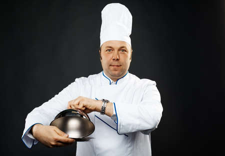 chefs whites: mature caucasian male chef over grey background Stock Photo