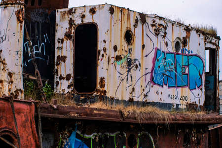 Graffiti old ship at abandoned port