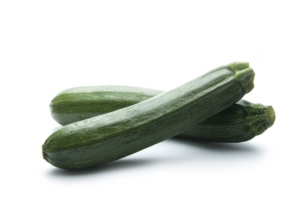 pair of green zucchini isolated on white background